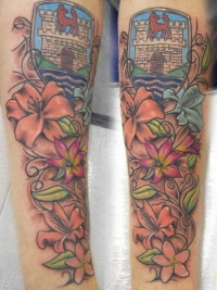 Vine tattoo with flowers and coat of arms