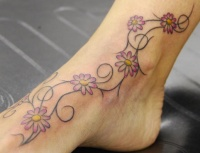 Vine of small chamomile leg tattoo