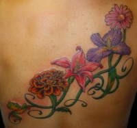Colorful different flowers on vine tattoo