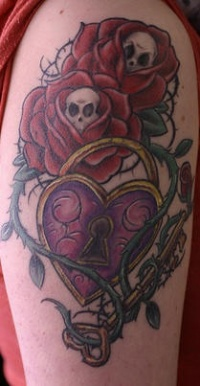 Rose and thorns vine tattoo with heart lock and key