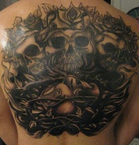 Dark black skulls and roses vine tattoo on back